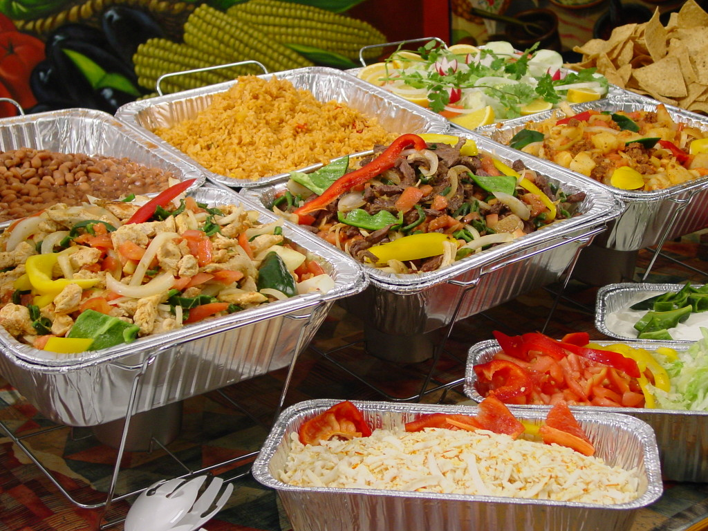 An image of food trays for catering - Mexican and Greek Food - NY