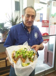 An image of an employee at Taste & Sabor, a Mexican and Greek Restaurant in the Kingsbridge section of Bronx, NY