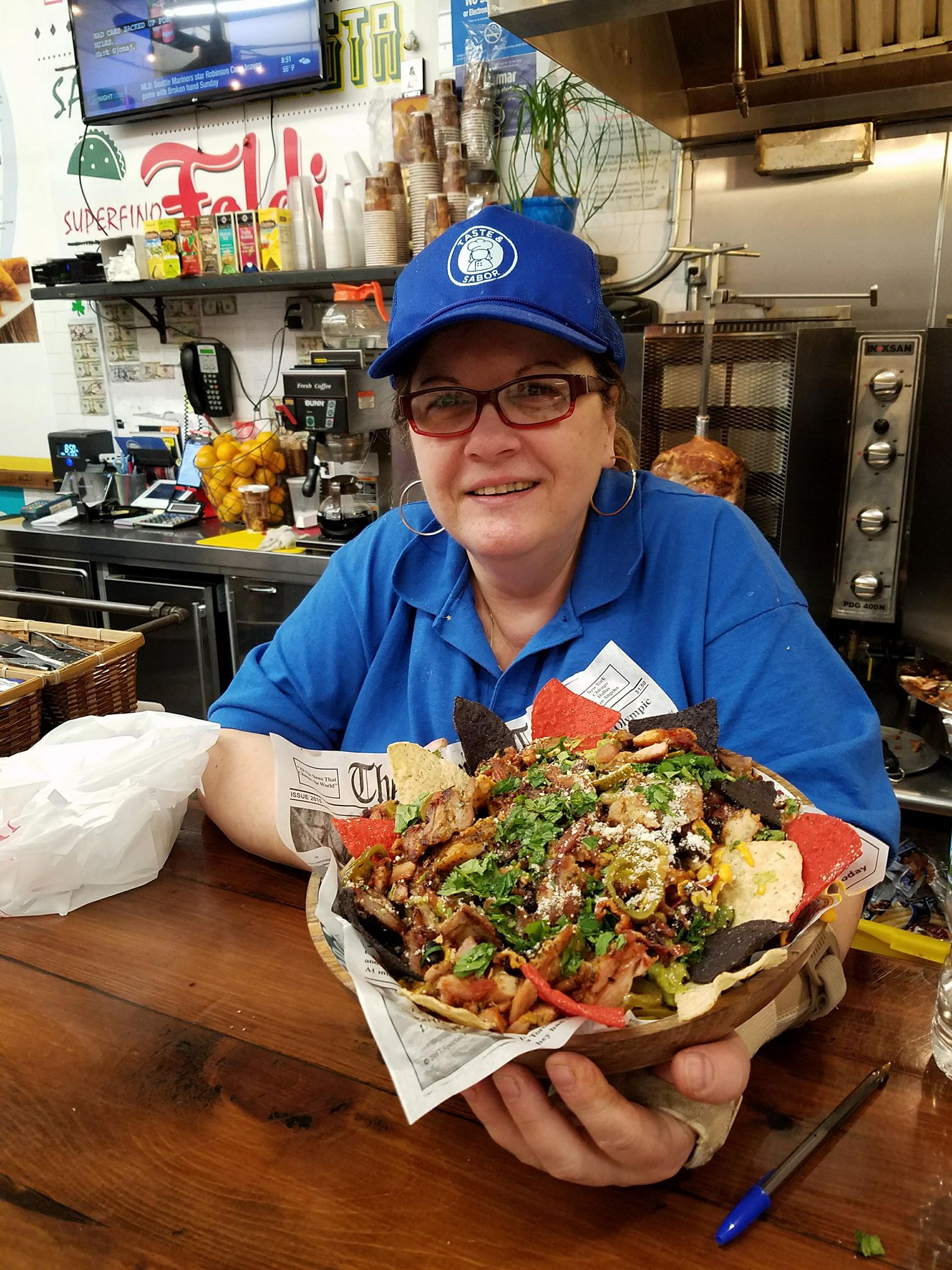 An image of a food employee at taste & sabor, A greek mexican restaurant in Kingsbridge, NY